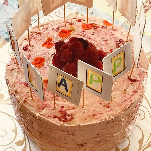 Lemon-Raspberry layer cake with slide holders. Birthday cake for a photographer