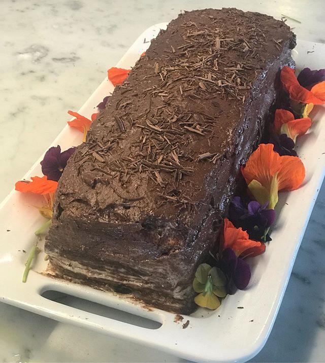 Luke Young's marjolaine birthday cake. Layers of almond meringue, whipped cream and ganache. Nasturtium from the garden. #marjolaine #nasturtium