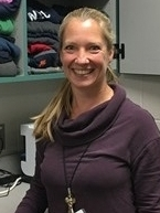 Julie Rolling, Mahtomedi Middle School Counselor, in front of the extra clothing she keeps on hand in her office for students in need.