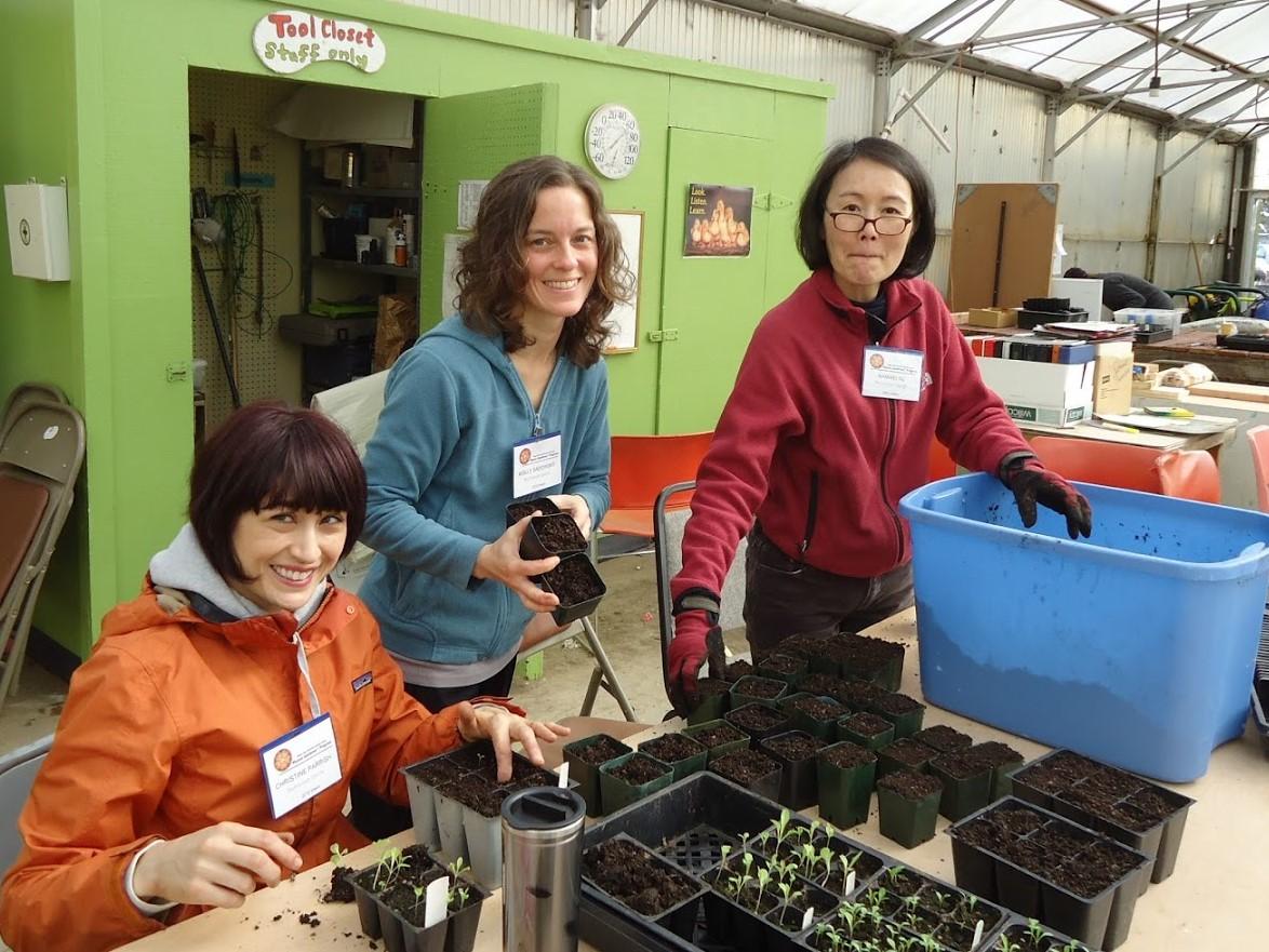 tending the seedlings at our community demonstration garden - photo courtesy of John Jordan