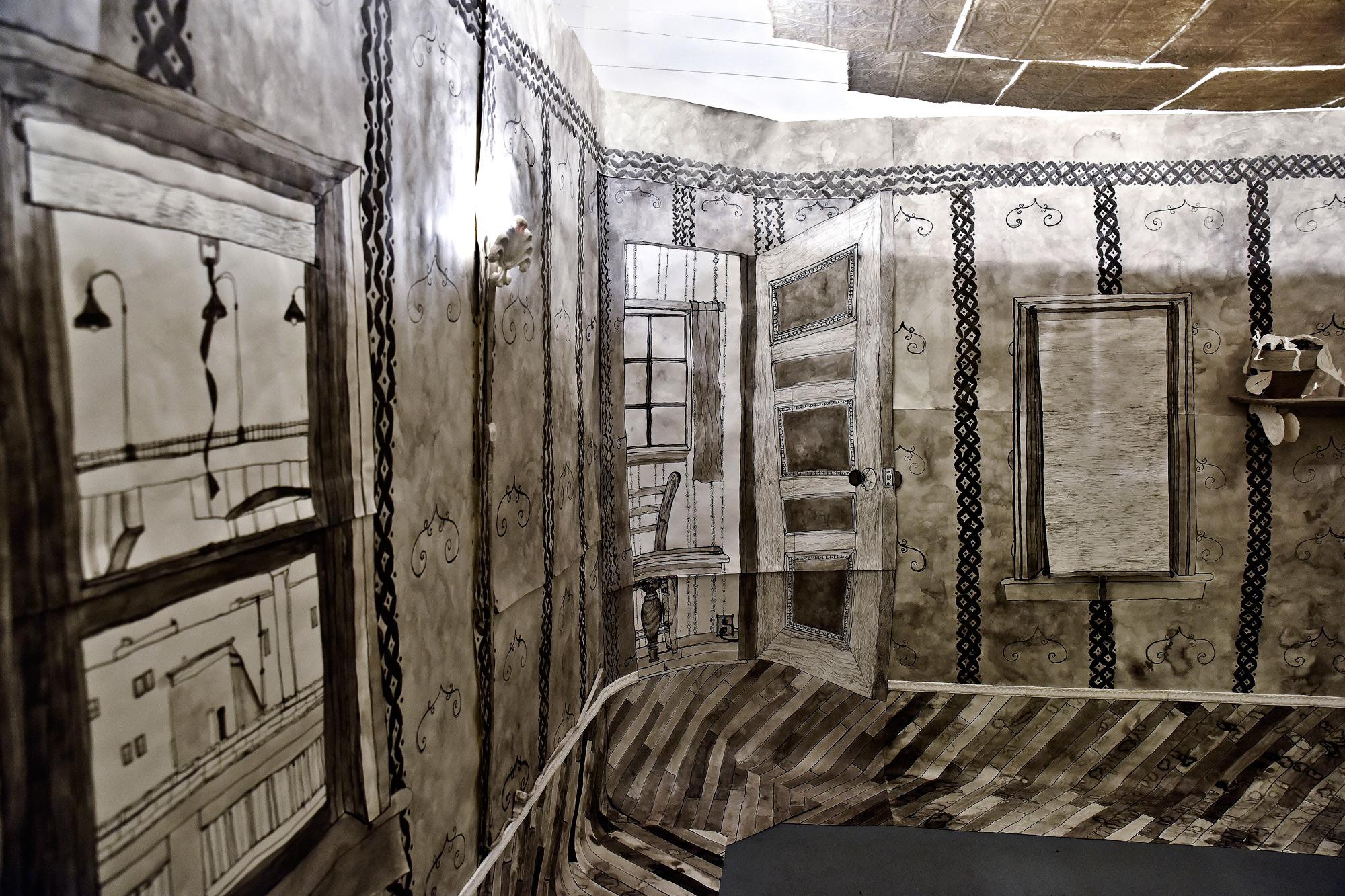 Retrofit , installation view. Paper, ink, wire, nails, light bulbs & fixtures, gel medium. 2015.