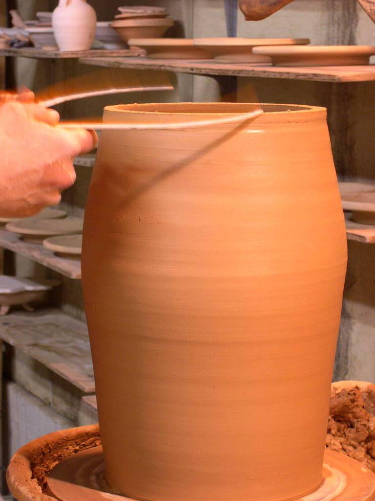 After the sections are thrown together and consistent, the rim is measured for the next cap.