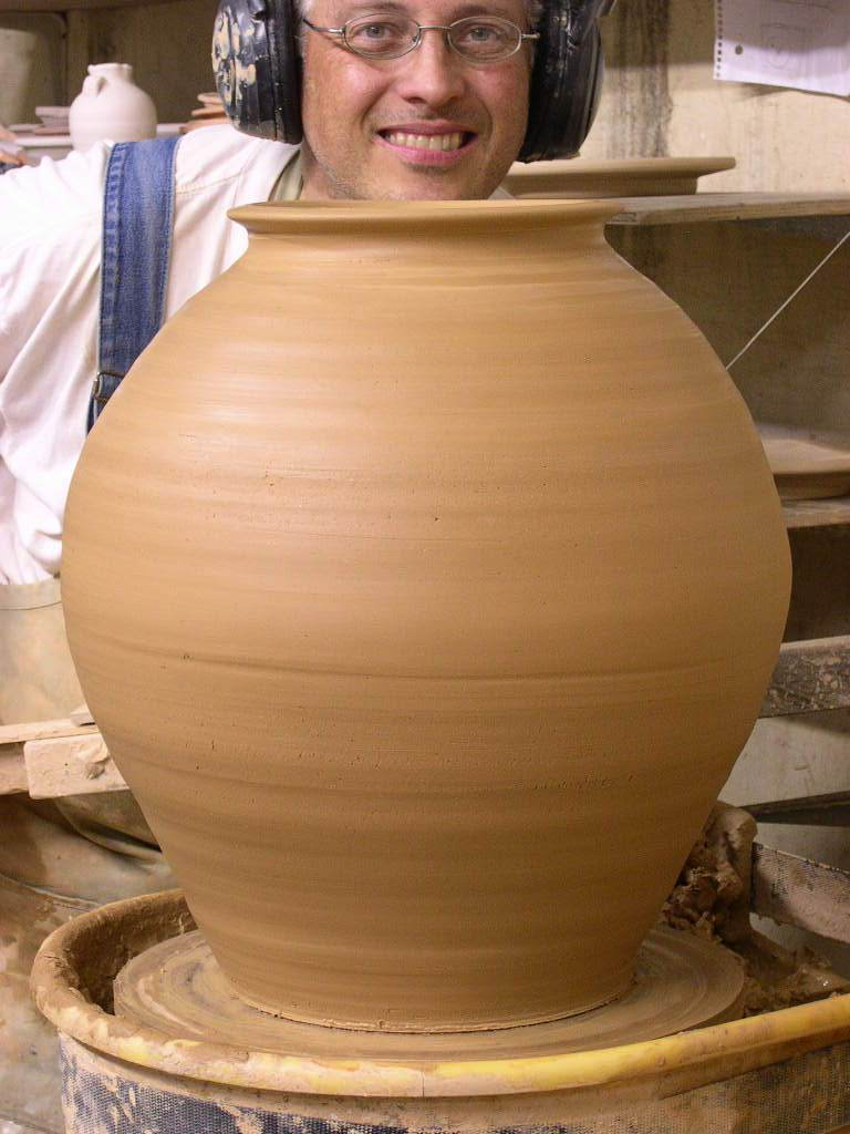 Here we see our geeky potter hamming it up after the work is done. Handles will go on the jar in the morning.