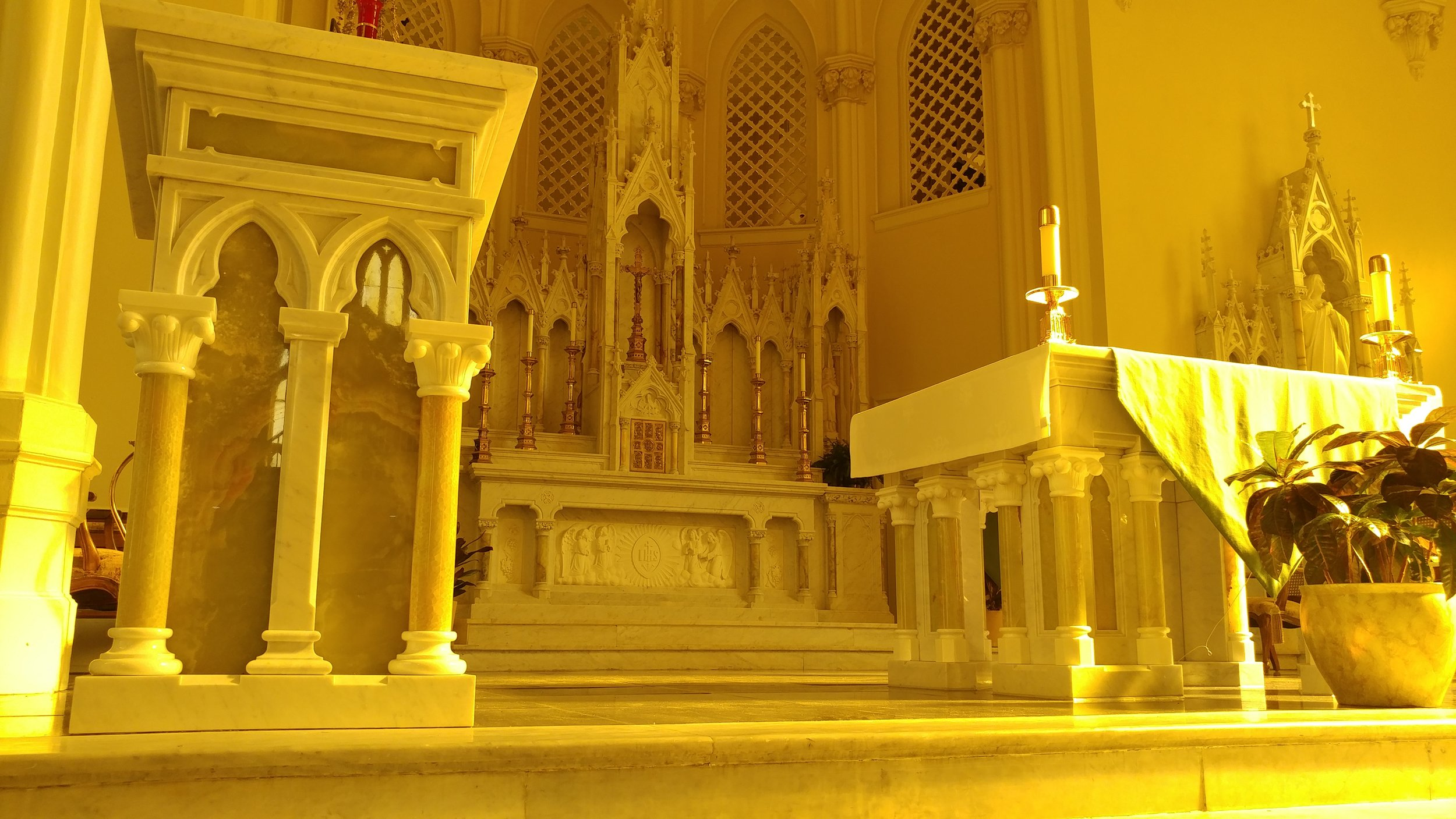 This photo was taken at the main altar at St. Joseph's Chapel located at Spring Hill College in Mobile, AL. Depending on where you stand in the afternoon at this gorgeous chapel, the altar is bathed in different colors. Taken at this angle, in this spot, at this time, the chapel basks in a vibrant gold light. To me, it is the most beautiful place of worship in the Archdiocese of Mobile.