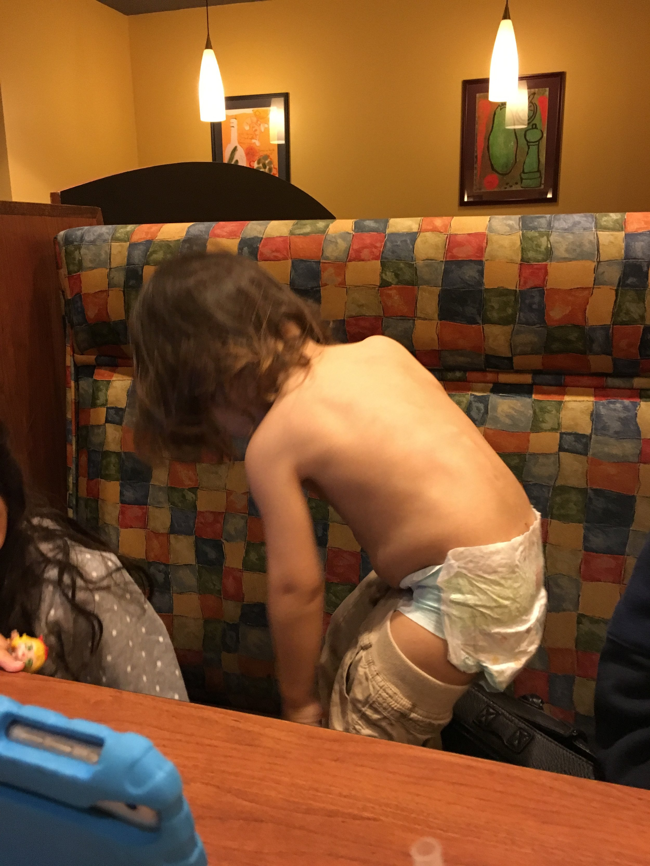 Dis guy , gets his shirt tiny bit wet from drinking water and does the full strip down in the restaurant  Seconds after a lady walks up to us and says how great the kids are.  Ha ha