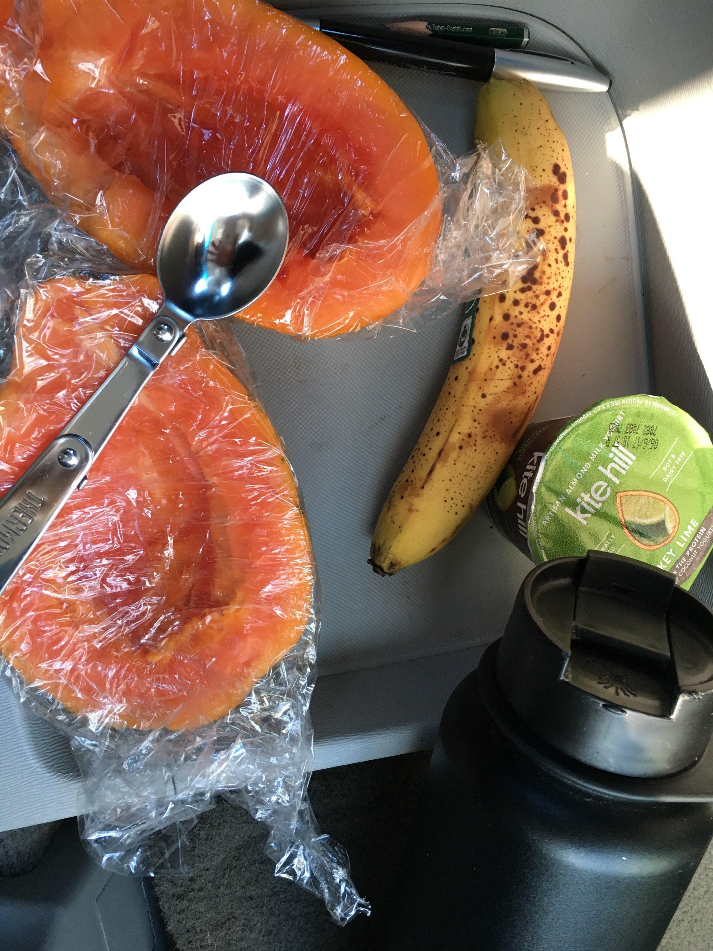 Breakfast on the go: organic papaya and banana with almond yogurt and water.