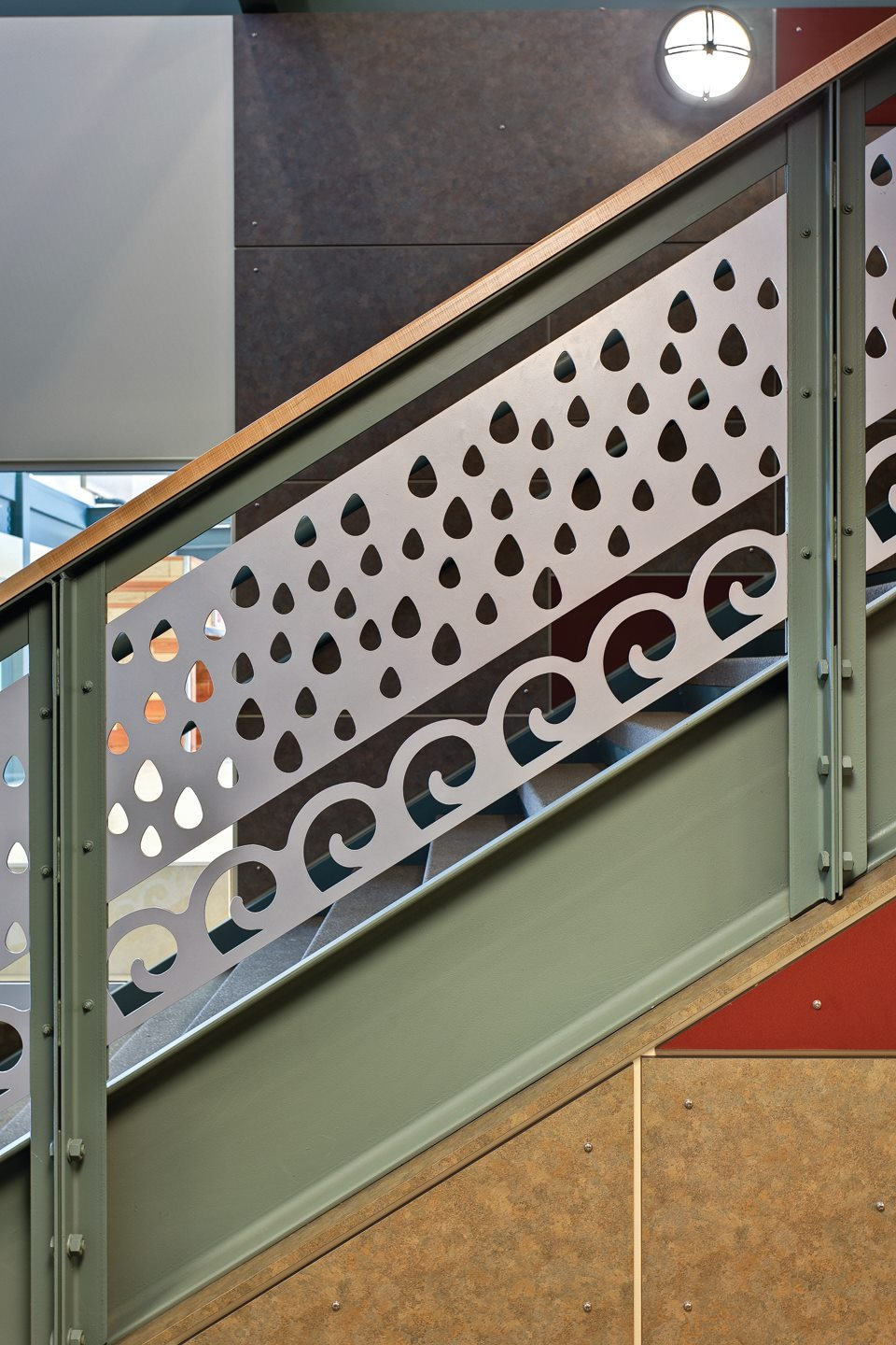 A stair rail I designed while working for the wonderful Portland firm,  DOWA  (now DOWA-IBI). My role included designing the custom rail, selected colors, and organized the pattern and finishes below the stair on the wall.