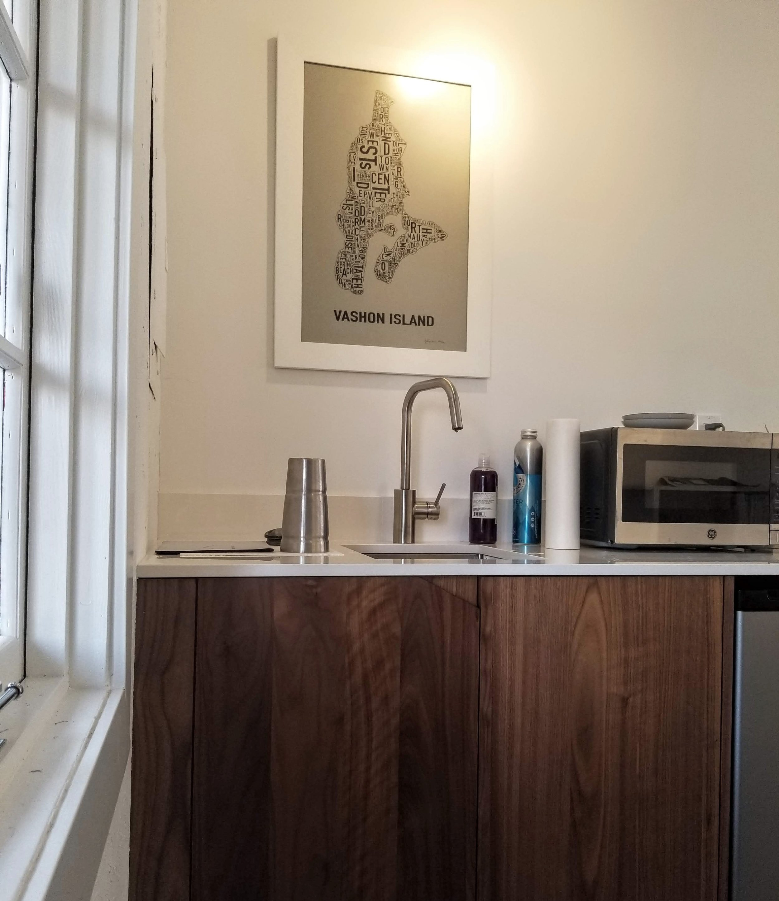 No, I did not stage this photo. I was too excited to have running water and thought the drying coffee mug was a thing of beauty. Kudos to those who find the 'handle' for my cabinets!