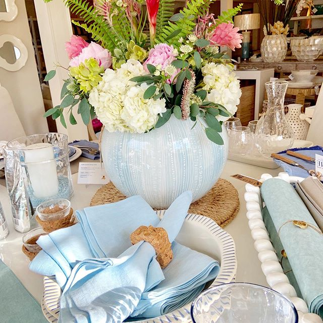 "Coastal inspired centerpiece at The Chatham Home. Signed ""Chatham"" Jill Rosenwald hand made ceramic vase #jillrosenwald Filled with flowers from Blossoms Flowers #blossomsofcapecod"