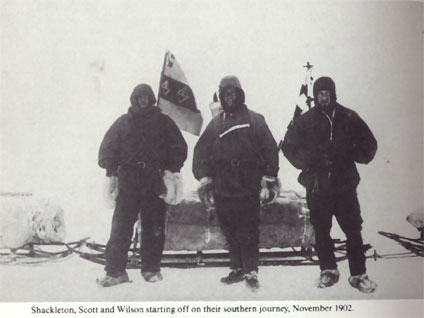 This picture shows (left to right) Shackleton, Scott and Wilson ; Shackleton's sledging flag showing the family coat of arms is well displayed.