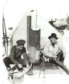 Hurley and Shackleton (right) in front of a blubber stove at Patience Camp.