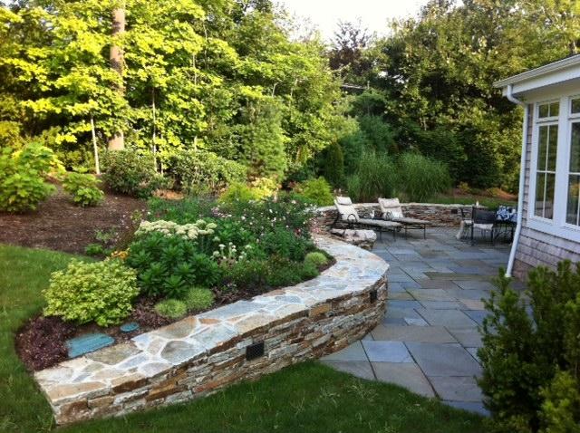 Bluestone patio and stone retaining wall.JPG