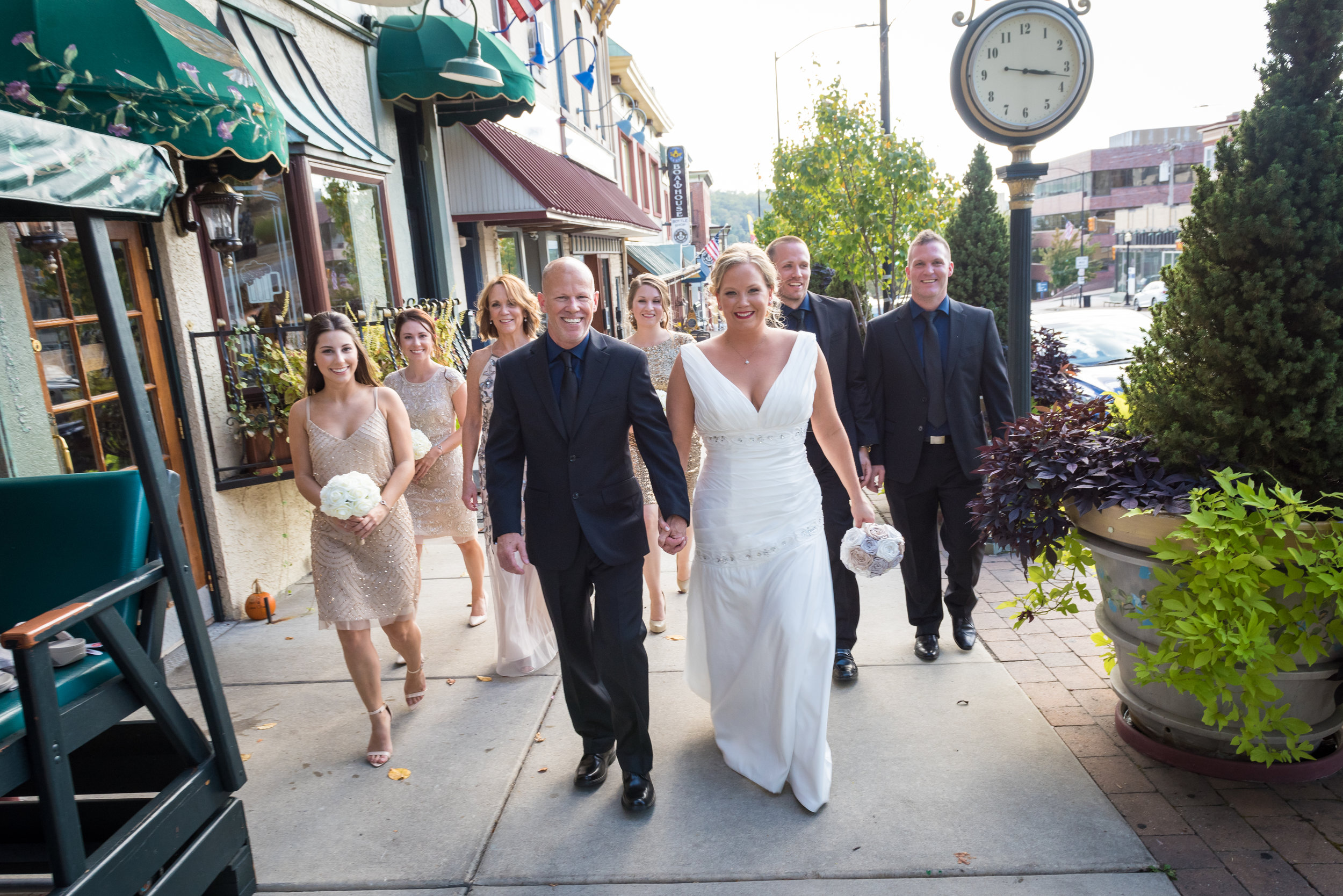 It was a great autumn day in Conshohocken, PA when Pat and Elisa decided to tie the knot at Great American Pub,123 Fayette St, Conshohocken, PA 19428. Here the bridal party walks up Fayette Street next to the infamous Conshy Time Clock.