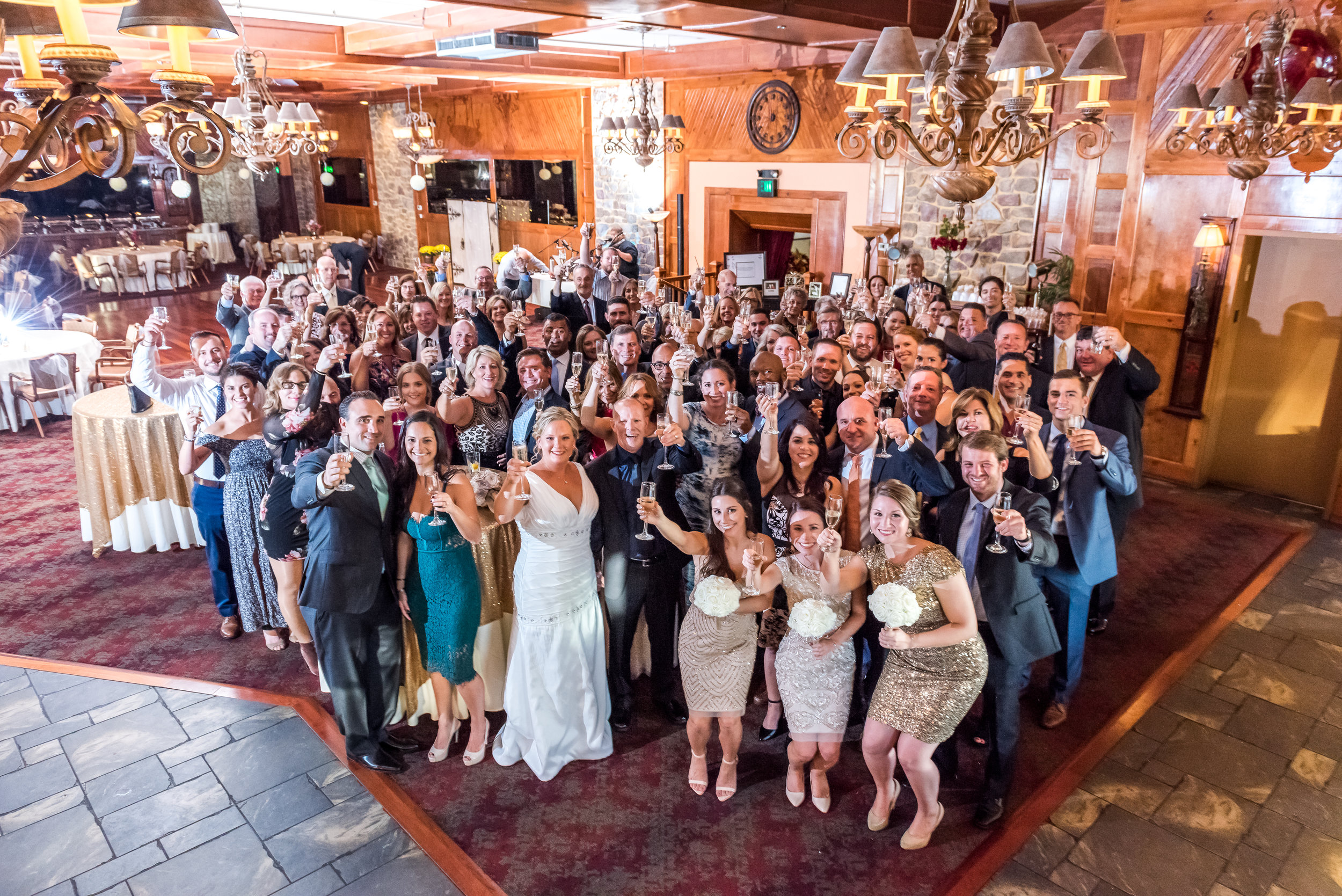 """Right after the """"I do"""" everyone got together for a champagne toast. Epic conclusion to the wedding!"""