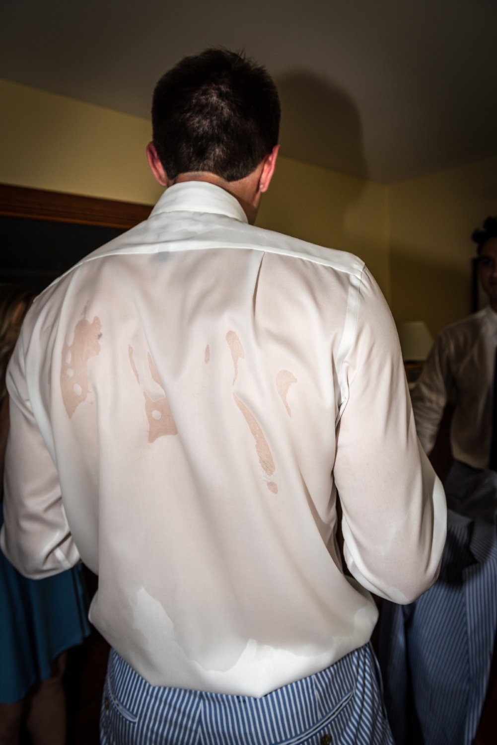 The groom soaked in sweat because It was 98 degrees in August