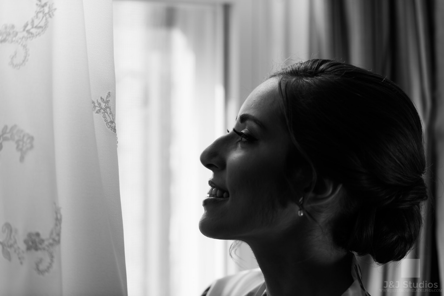 bride-gets-ready-at-window