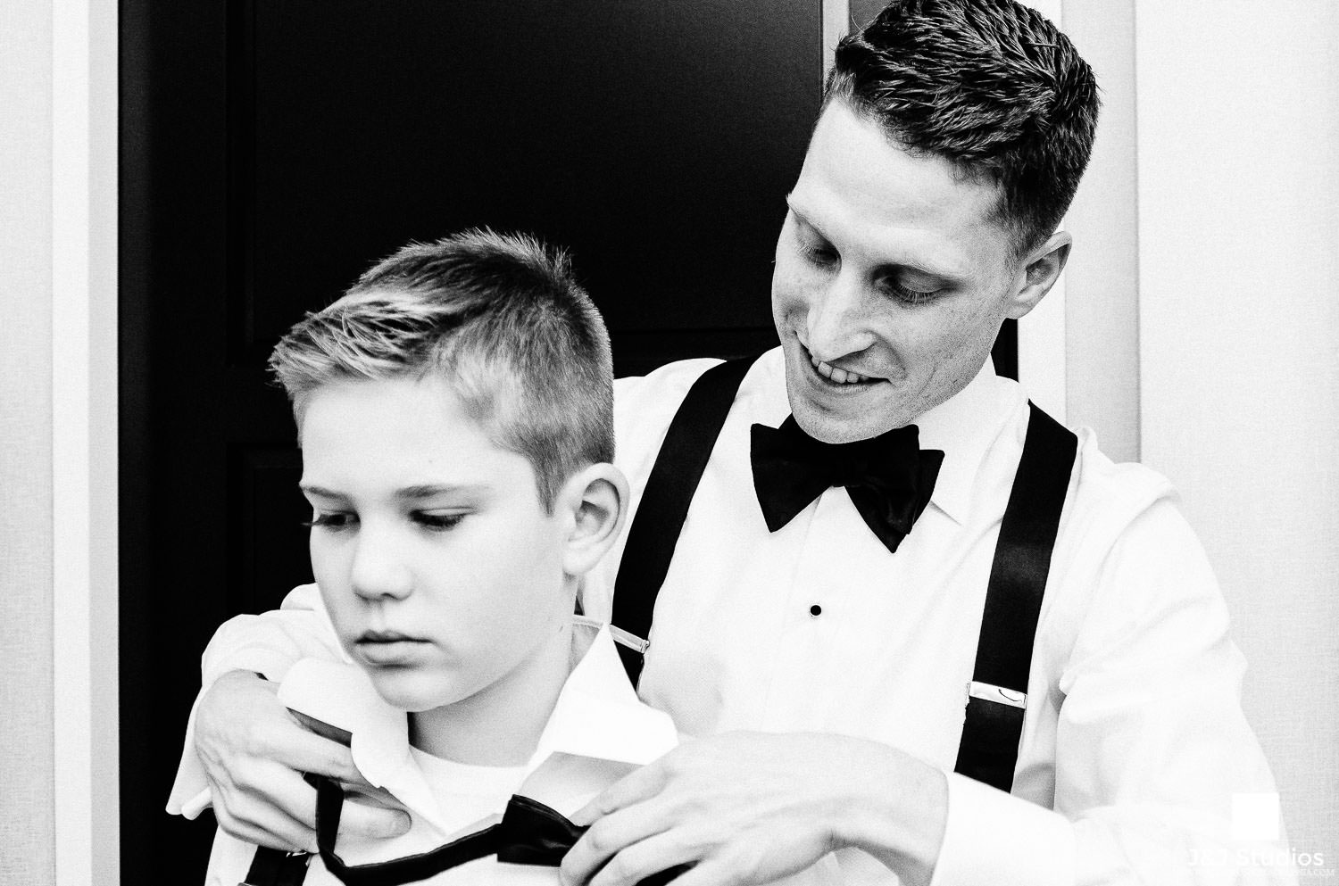 groom and ring bearer get ready