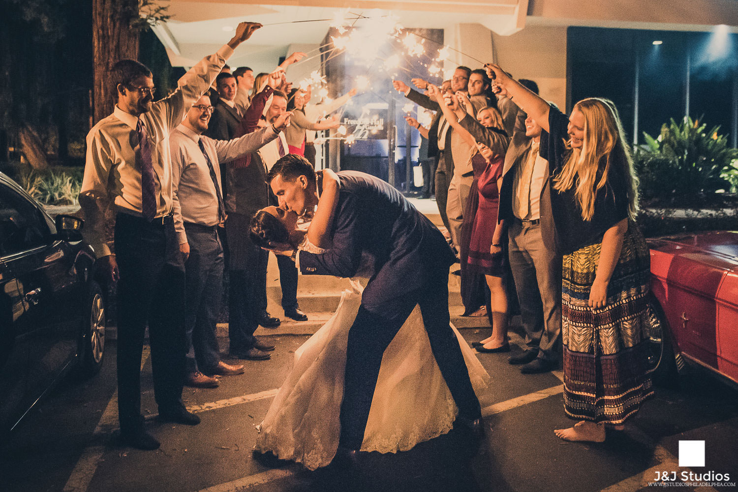 sparkler-exit-wedding-photo-kiss