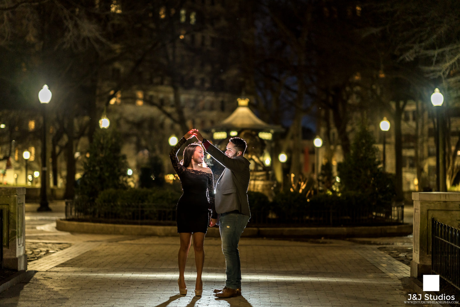 couple dancing in rittenhouse square engagement photos