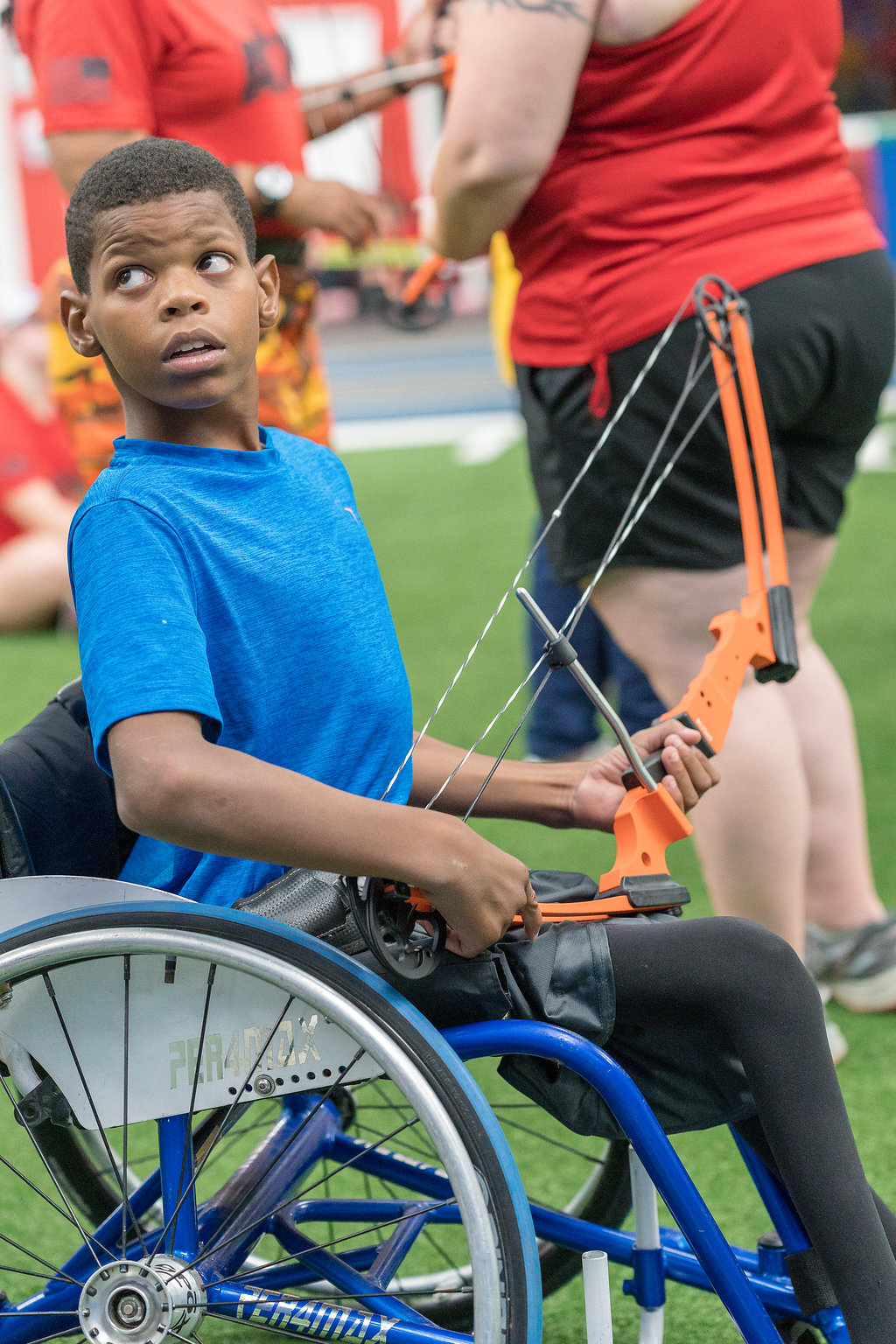wheelchair archery black boy wheelchair arrow bow