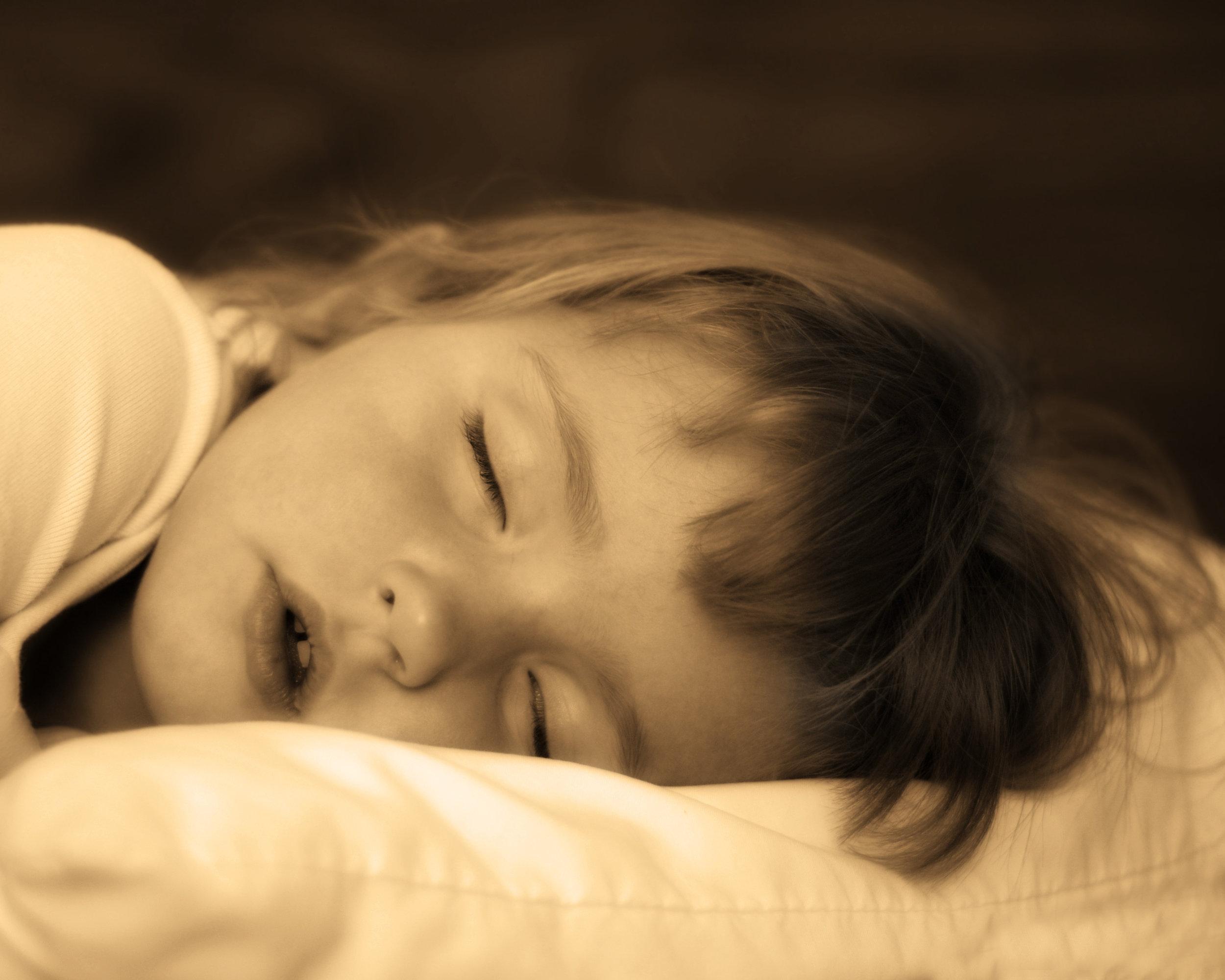 bigstock-Little-girl-sleeping-on-bed-wi-26175545.jpg