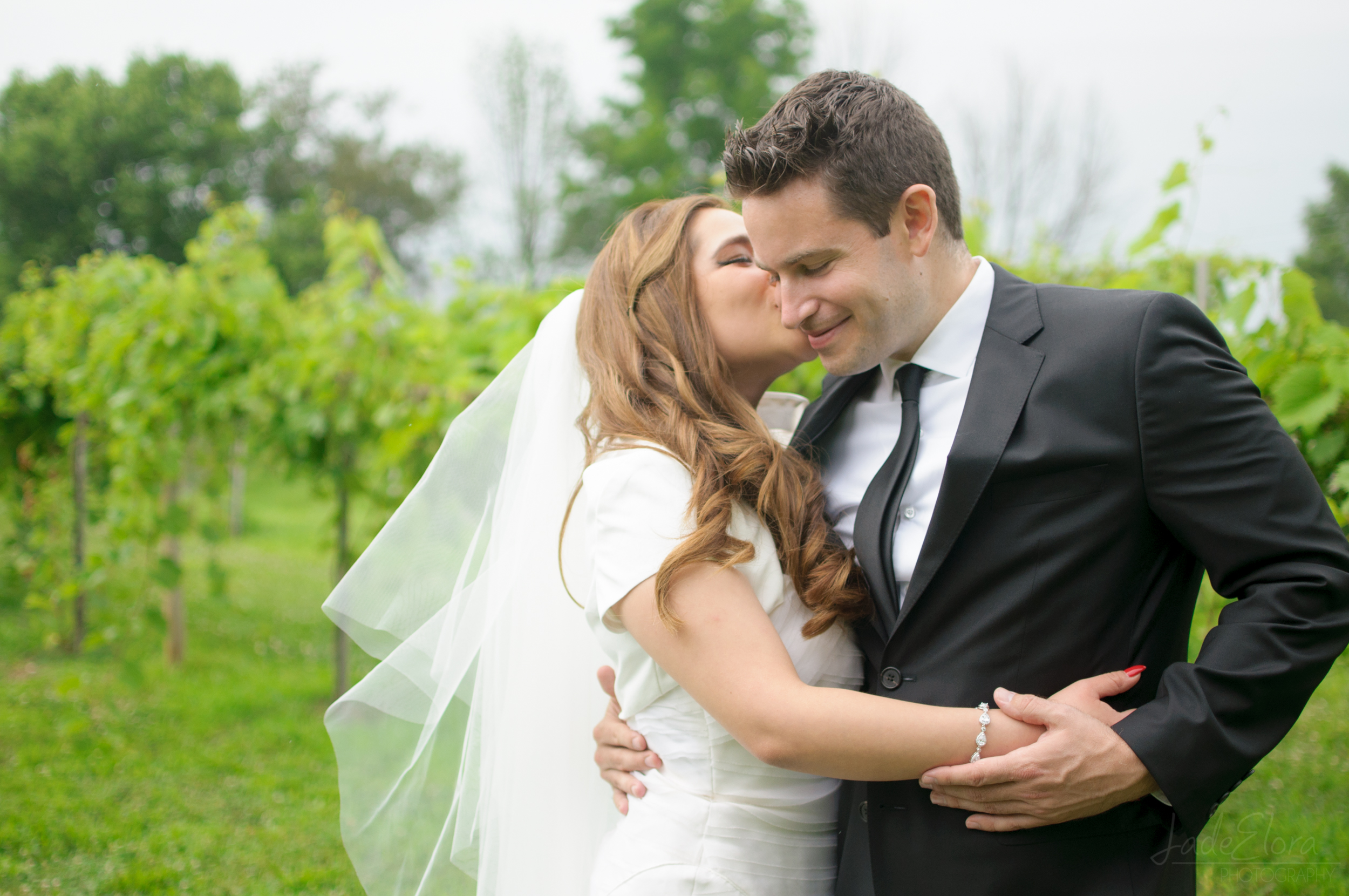 Cute Kiss Wedding Photo Vineyard