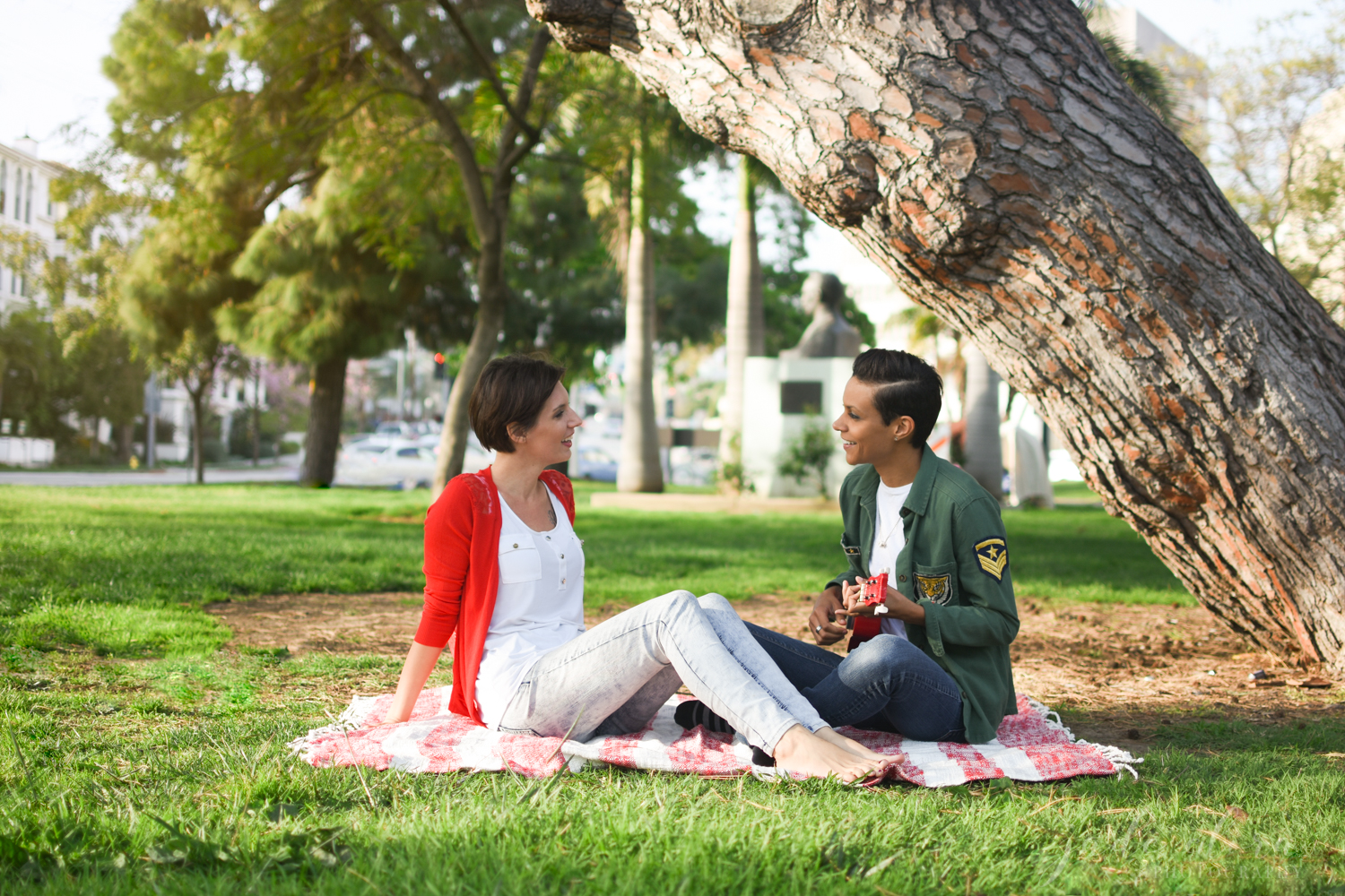 Woman Serenades Her Female Fiancé with Ukulele at Picnic