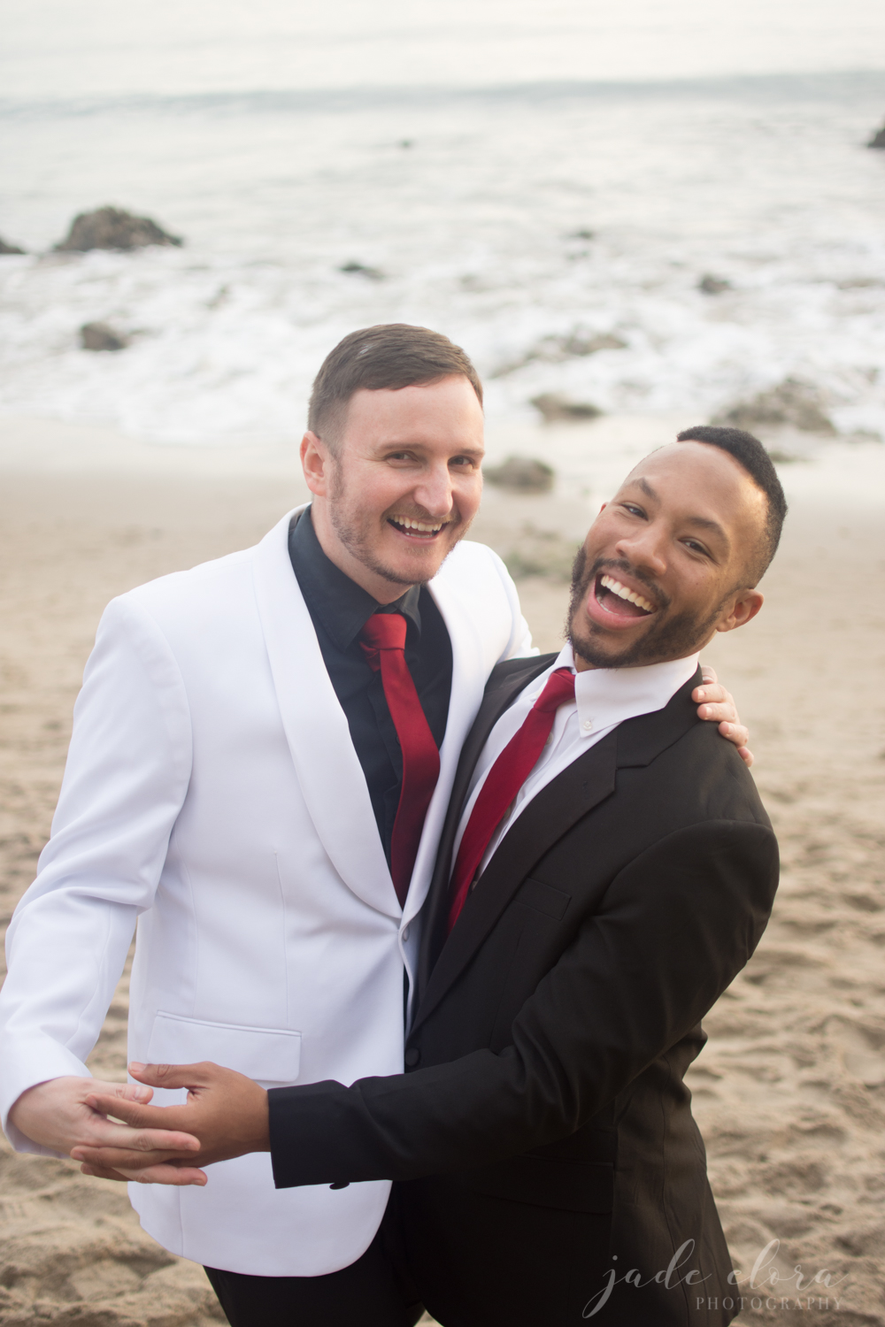 Gay Male Couple Laughing and Hugging