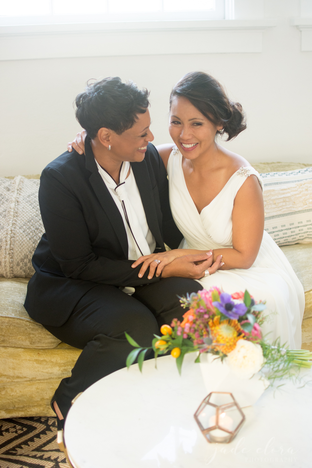 Same Sex Brides Cuddling on a Couch
