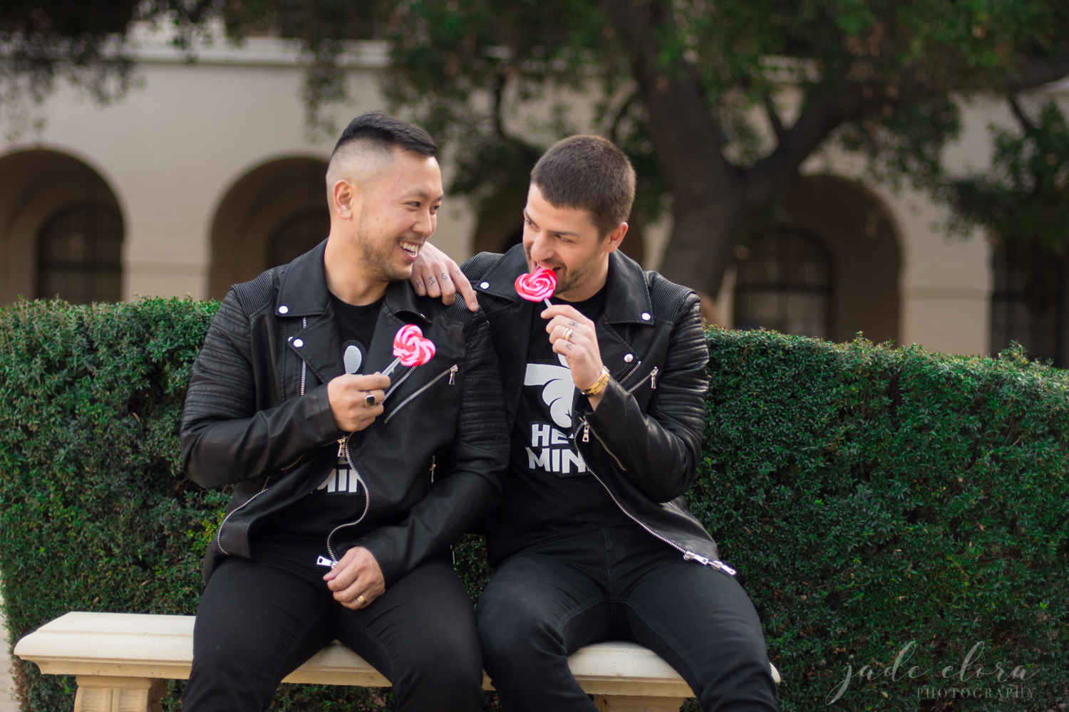 Same-Sex Male Couple Playing with Heart Lollipops