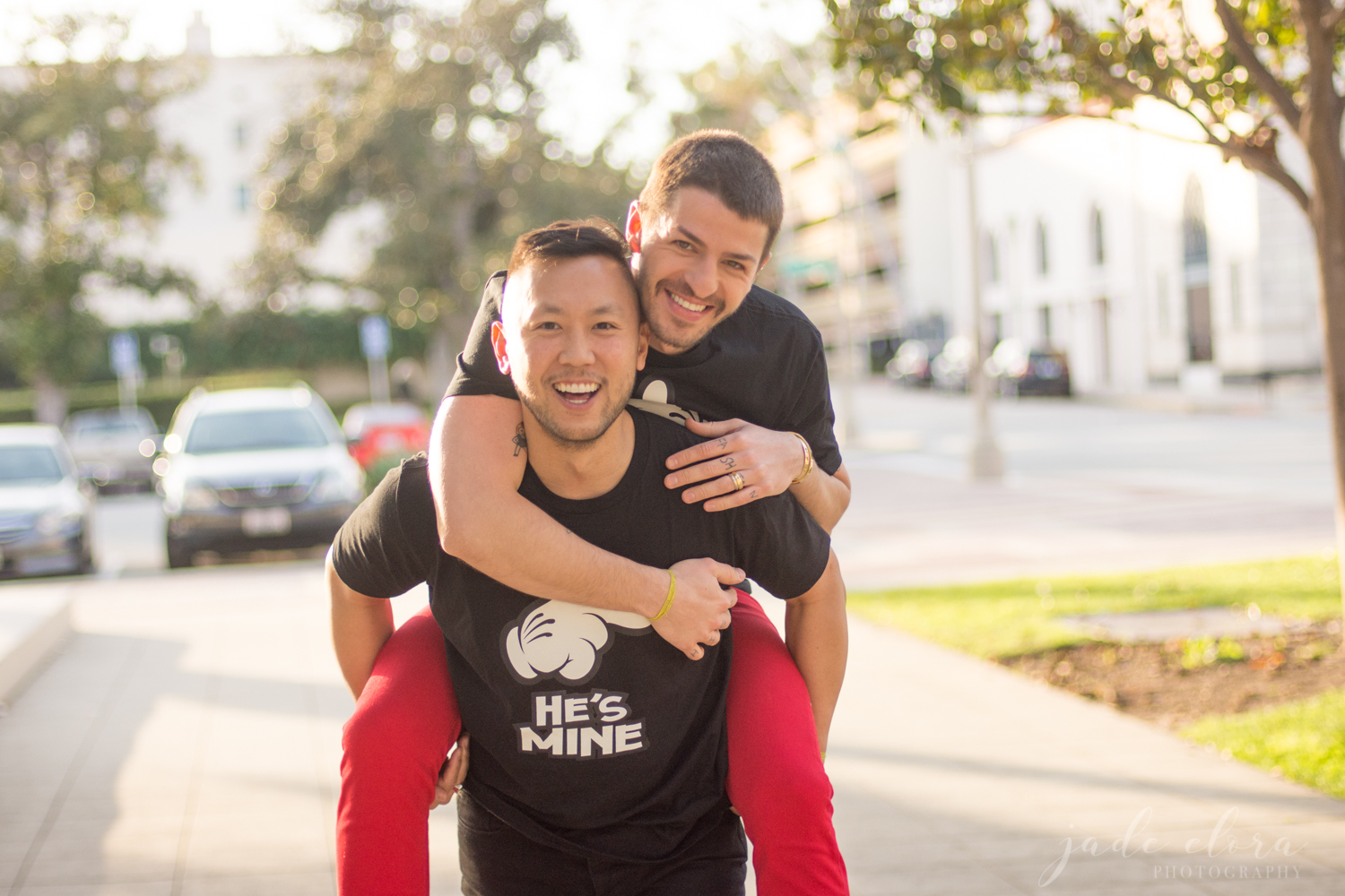 Gay Man Carries His Husband on Piggy Back While Both Laugh