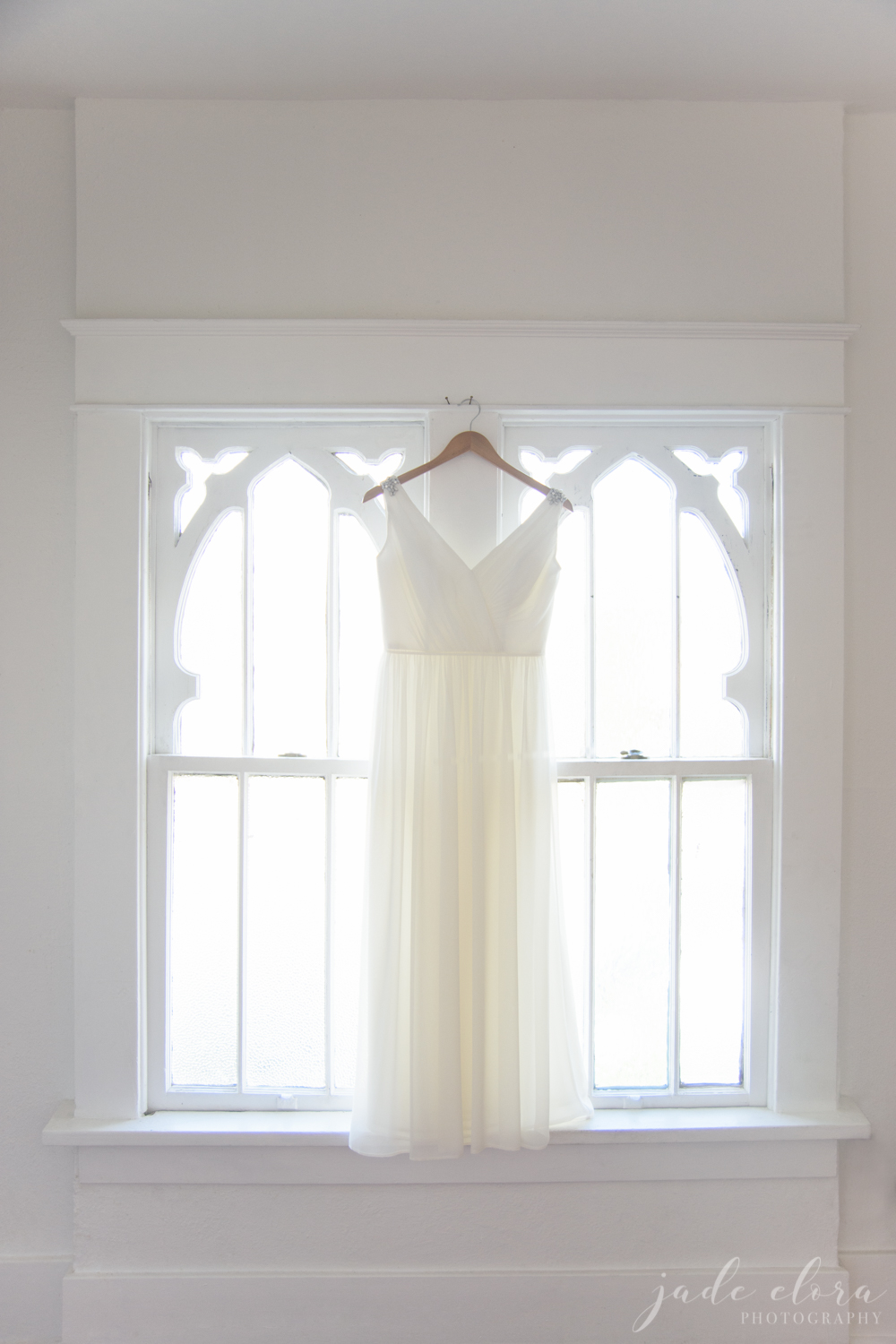 Short Wedding Dress Hangs in a Window at The York Manor
