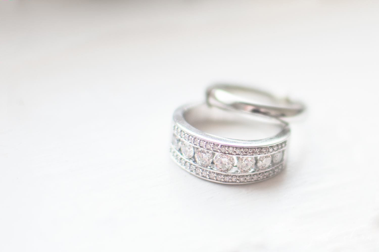 Two Womens' Wedding Bands - One Ornate and the Other Simple