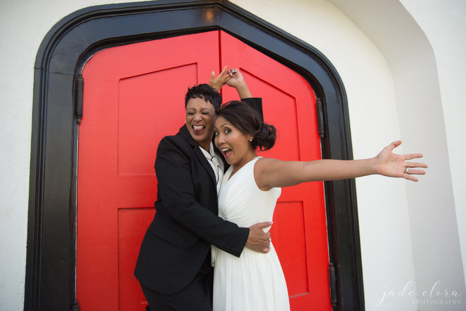 Newlywed Lesbian Couple Celebrates in Front of Red Doors of The York Manor