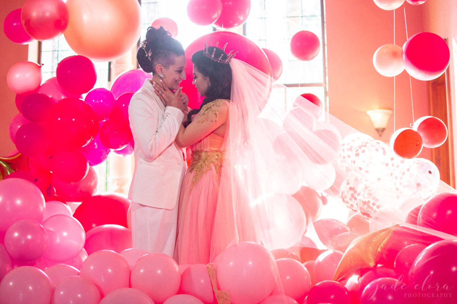 Same-Sex Brides Surrounded by Red and Pink Balloons