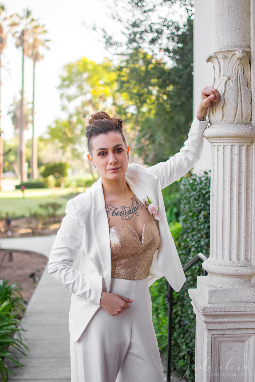 Queer Tattooed Bride in White Jumpsuit with Gold Sequin Top