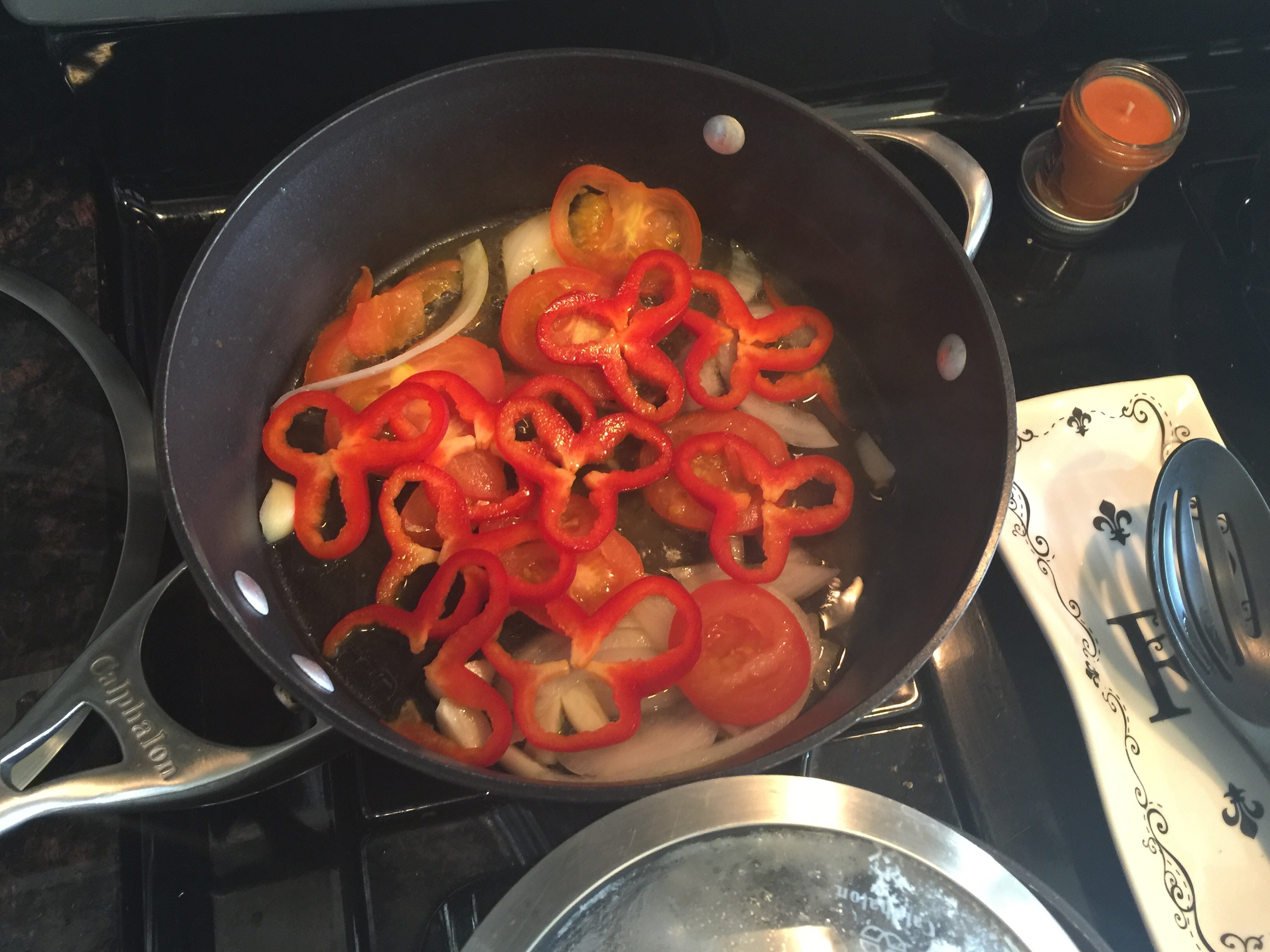 Meanwhile sauté your fresh tomatoes, onions, and red bell pepper with olive oil & fresh garlic.
