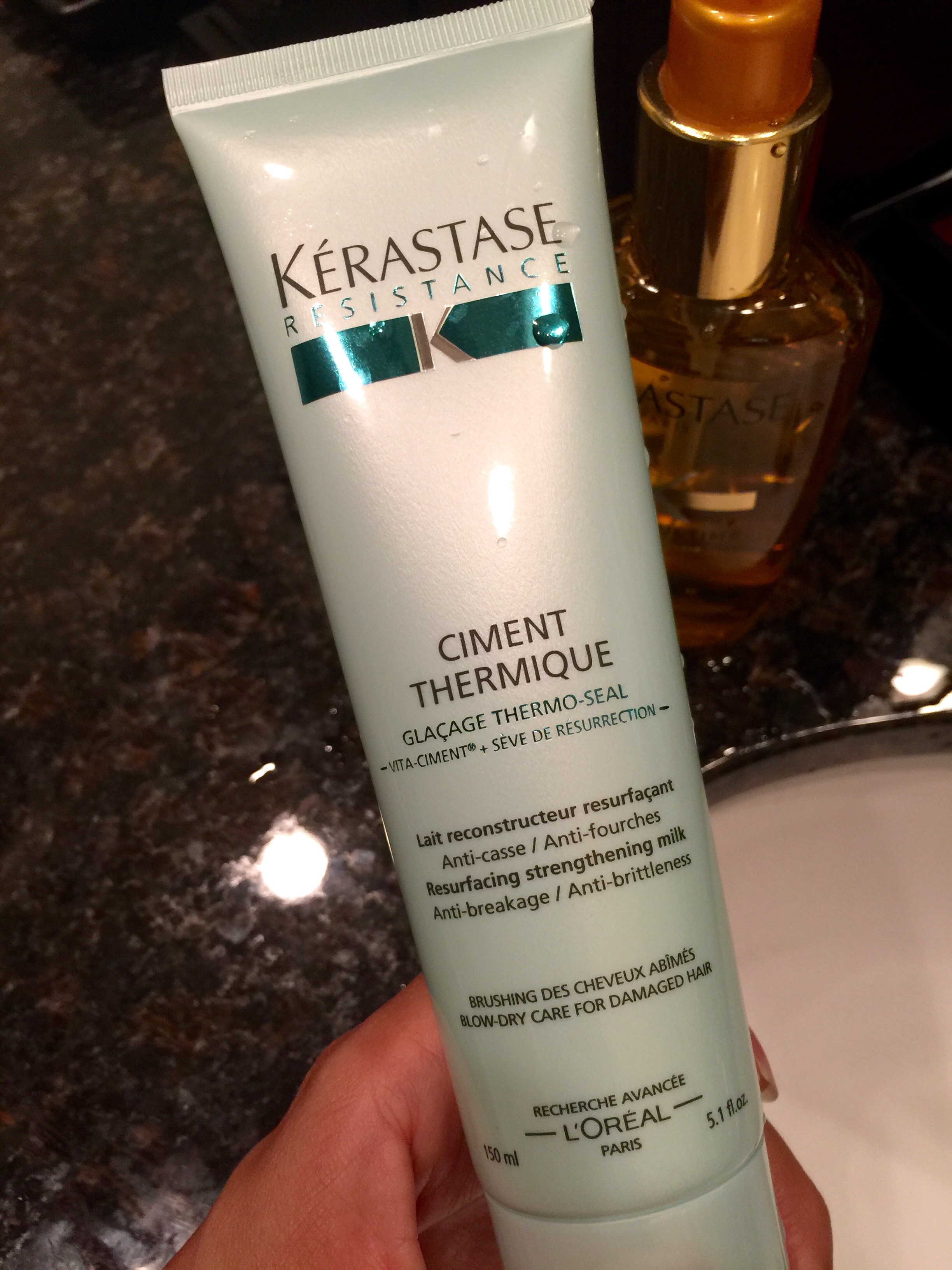 Kerastase   (Ciment Thermique)   is by far the best product line I've tried! Every morning I use hot tools on my hair so I make it a point to apply this the night before. I use about a quarter sized amount and lather it in to the ends of my hair.