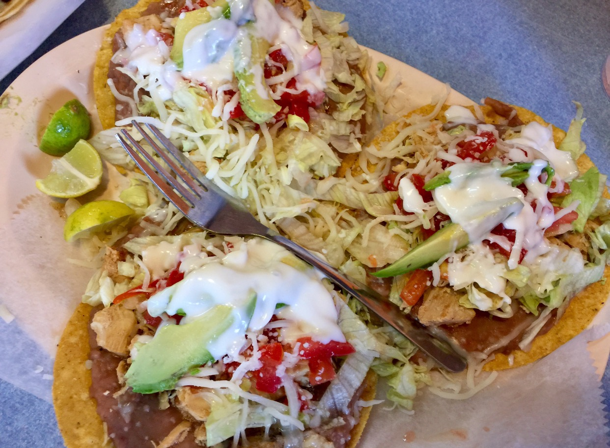 Tostadas!! Another of my favorite eats! Check out these fried tortillas with beans, lettuce, tomatoes, avocado & topped with sour cream.