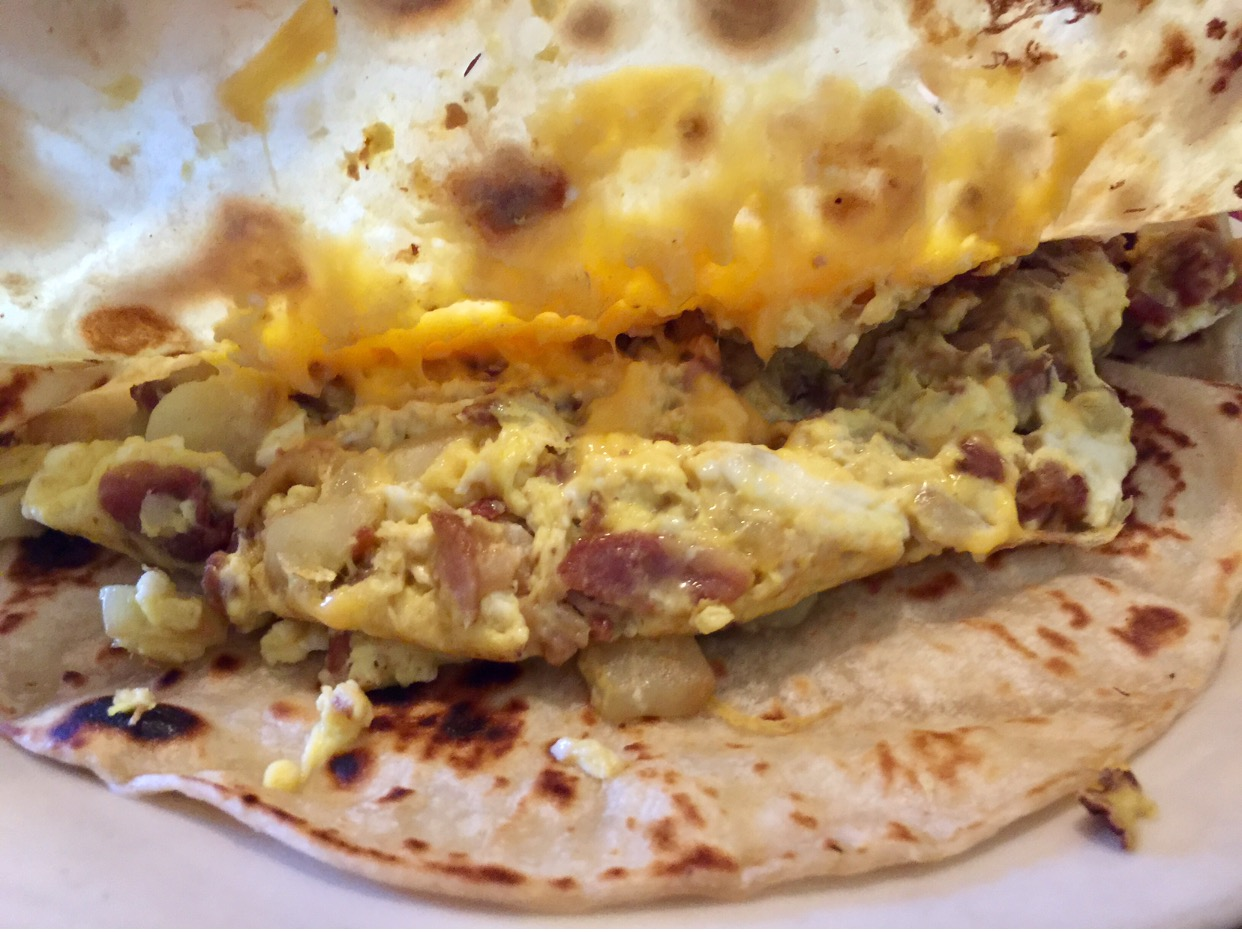 Breakfast Tacos: all of them are delicious & big enough to share. This one I ordered has egg, potatoe, bacon, cheese & a side of refried beans.