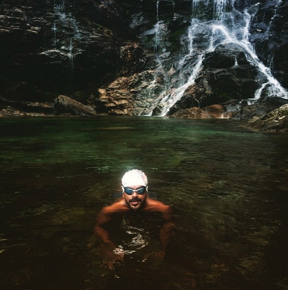Photographer Selvaprakash Lakshmanan bathing in Sonogno Valle Verzasca  (photo Diana Markosian, Armenia/USA - from artist instagram account)