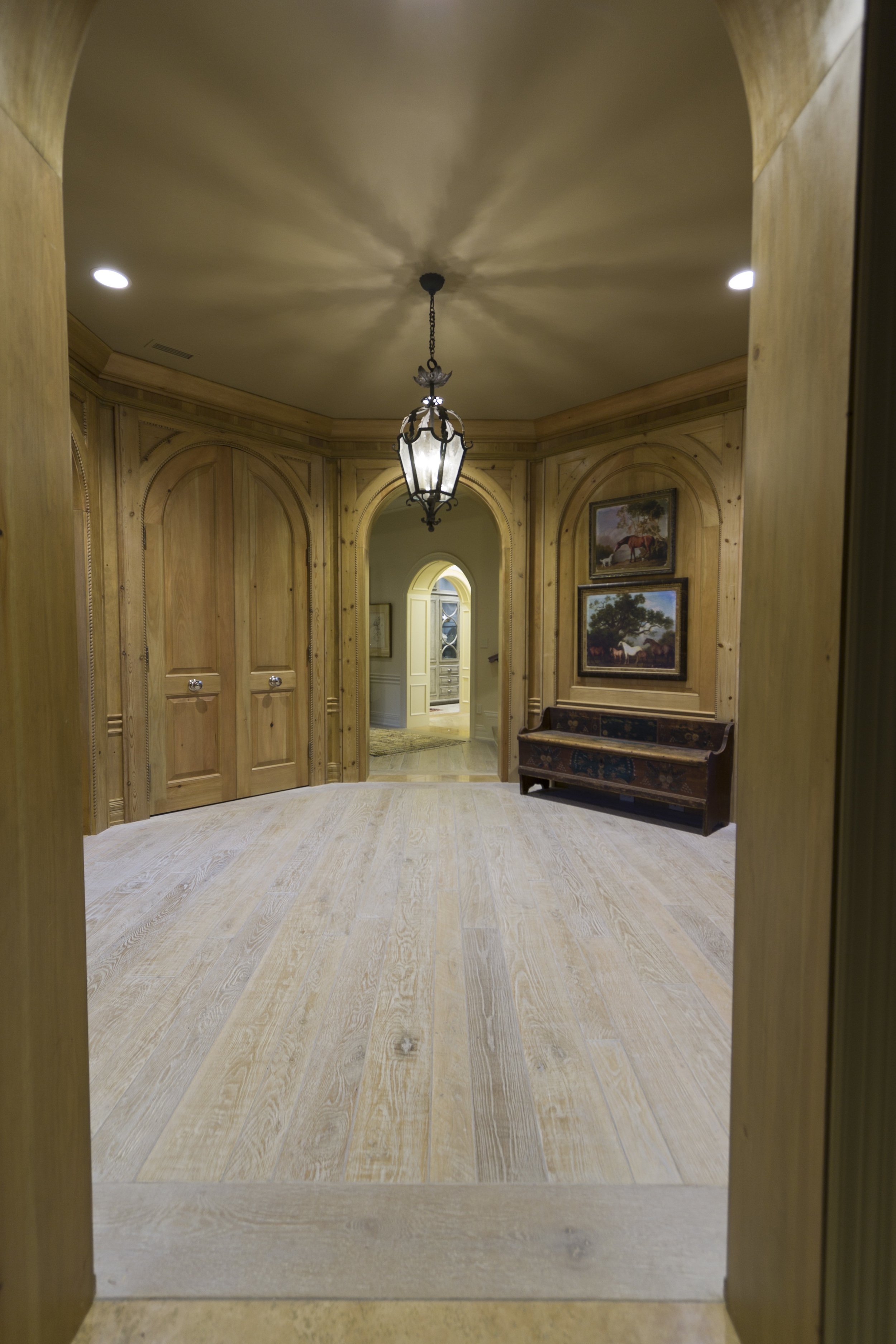 Beautiful chevron parquet from reclaimed oak, antiqued, stained, burnished with vegetable oils and waxed with beeswax. Custom parquet designed for an upstate mansion. Wide planks.