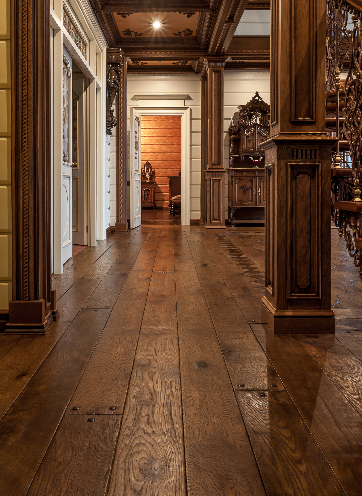 Custom made dovetail pattern and complementary borders and wide planks in reclaimed oak, antiqued, stained and burnished with vegetable oils and waxed with beeswax.