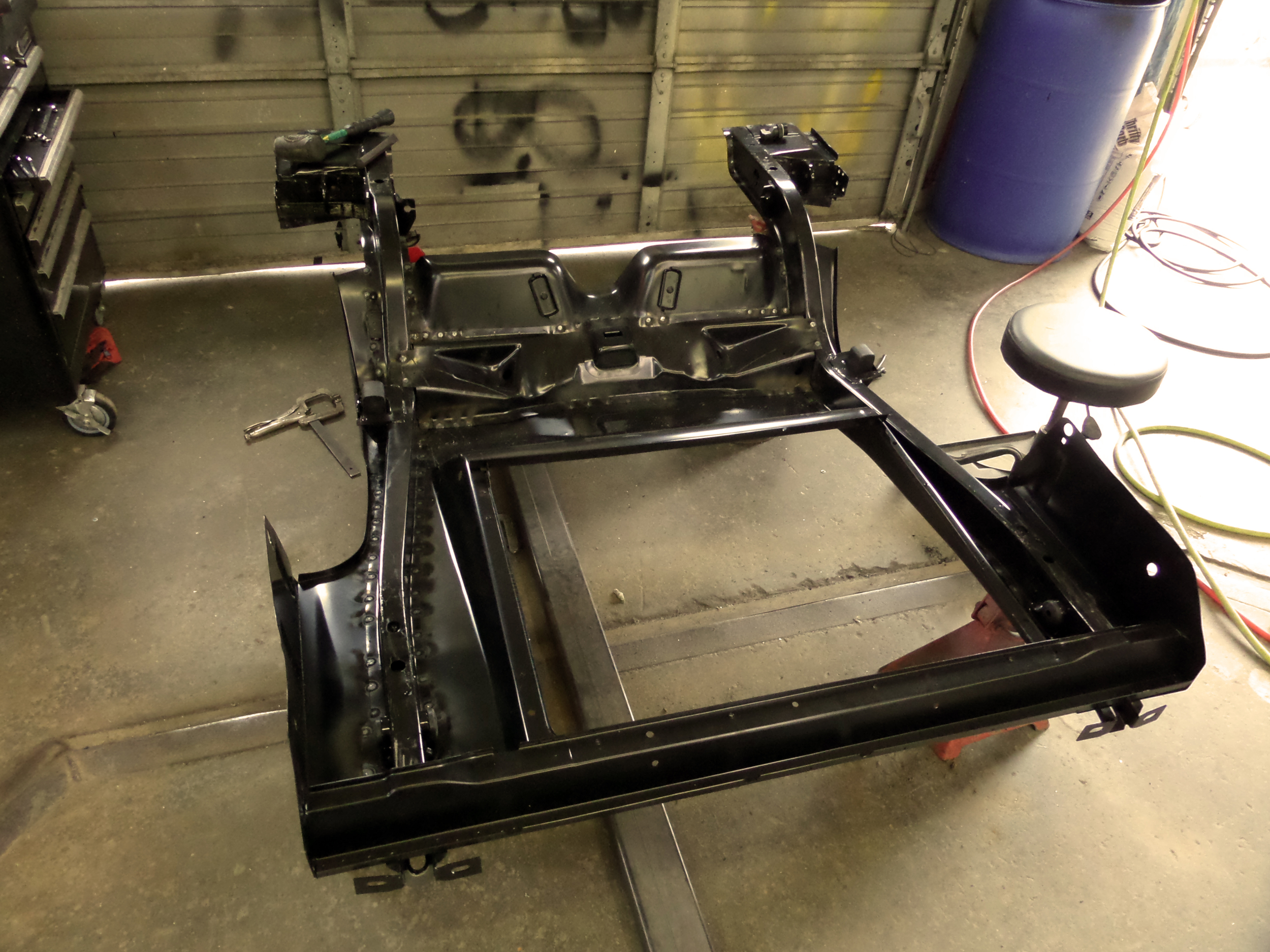 Rear frame rails and trunk pan