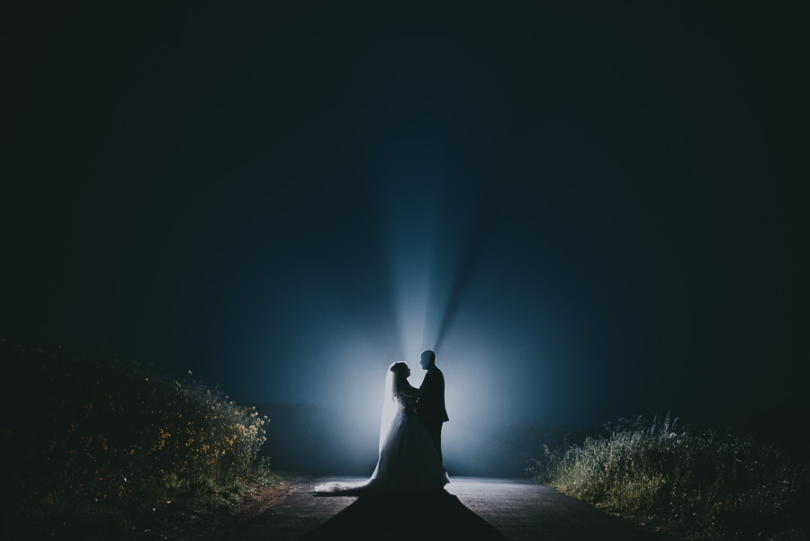 Bride and groom in foggy light