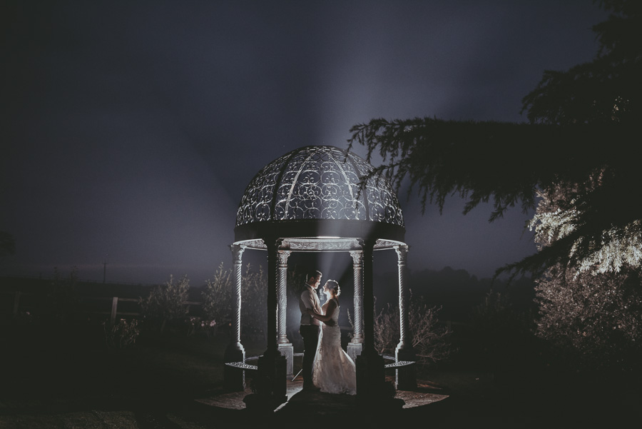 Bride and groom lit up at night