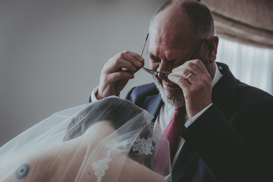 Father of bride crying with his daughter