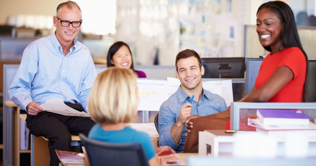 happy-colleagues-having-a-meeting-in-open-plan-office-1200x630-1024x538.jpg