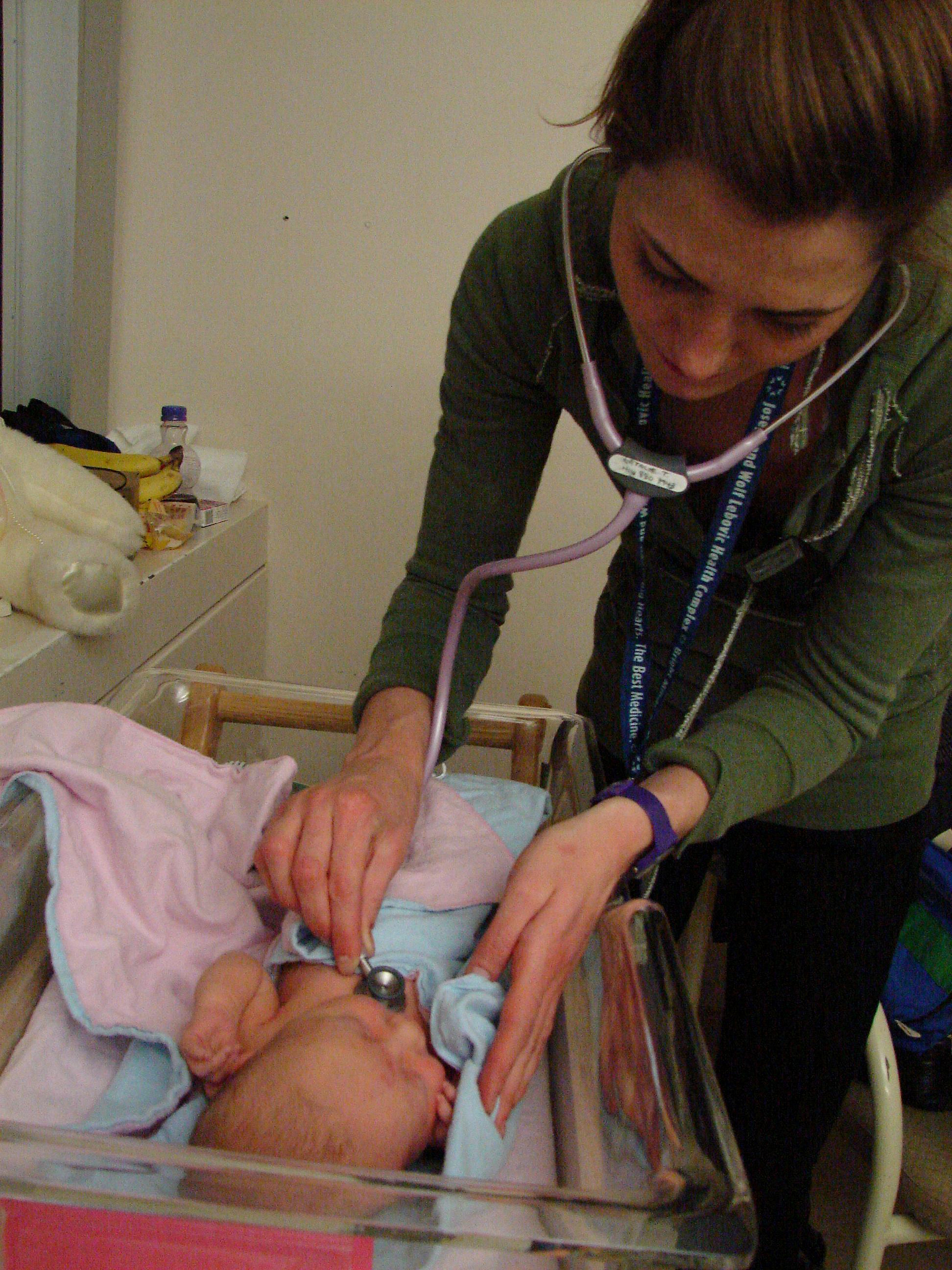 Midwife Caring for a Newborn, Photo by Jon Hayes