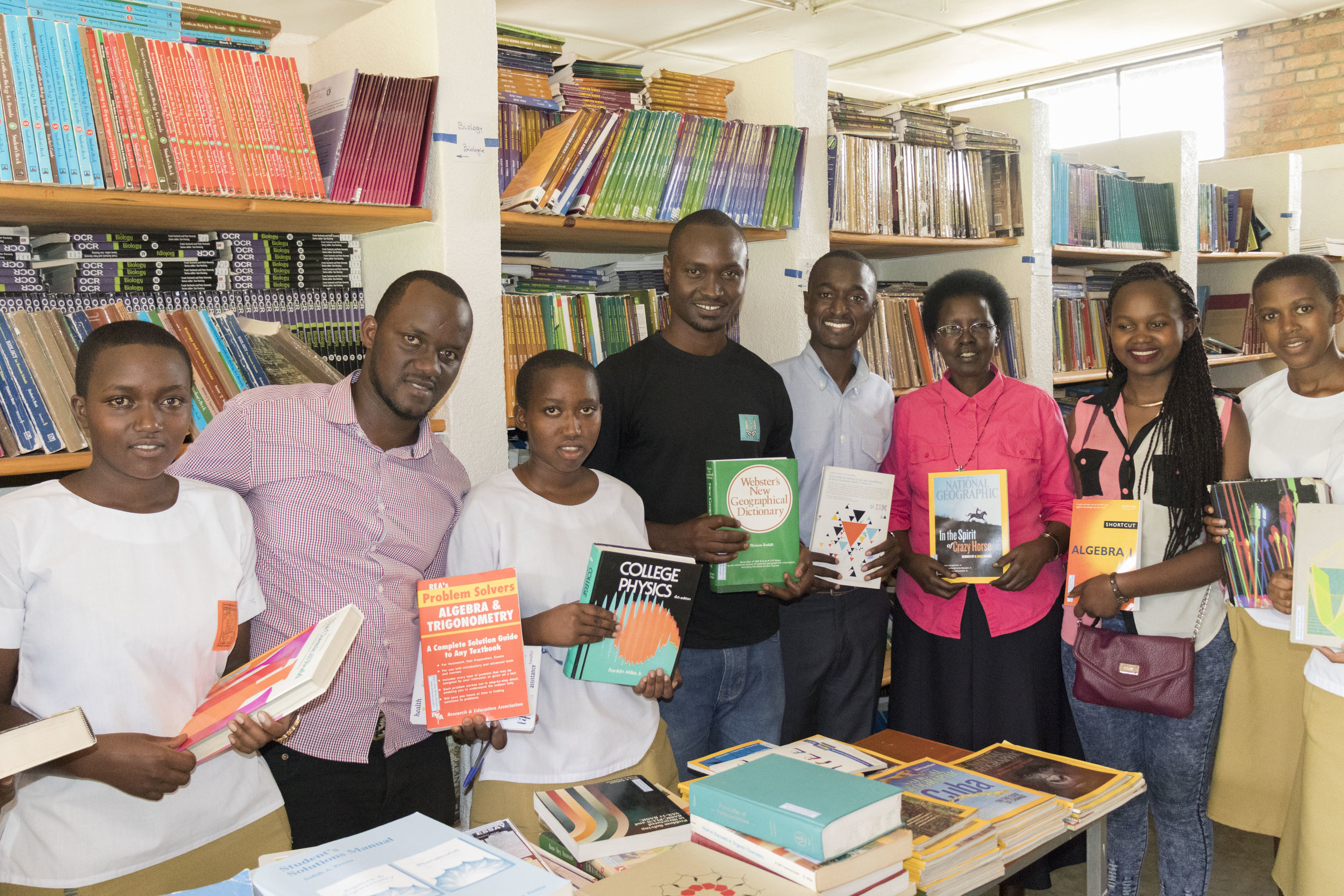 Headmistress Sister Philomene Nyirahuku (Center) poses with her students, Justus and Seven United Leadership for a photo